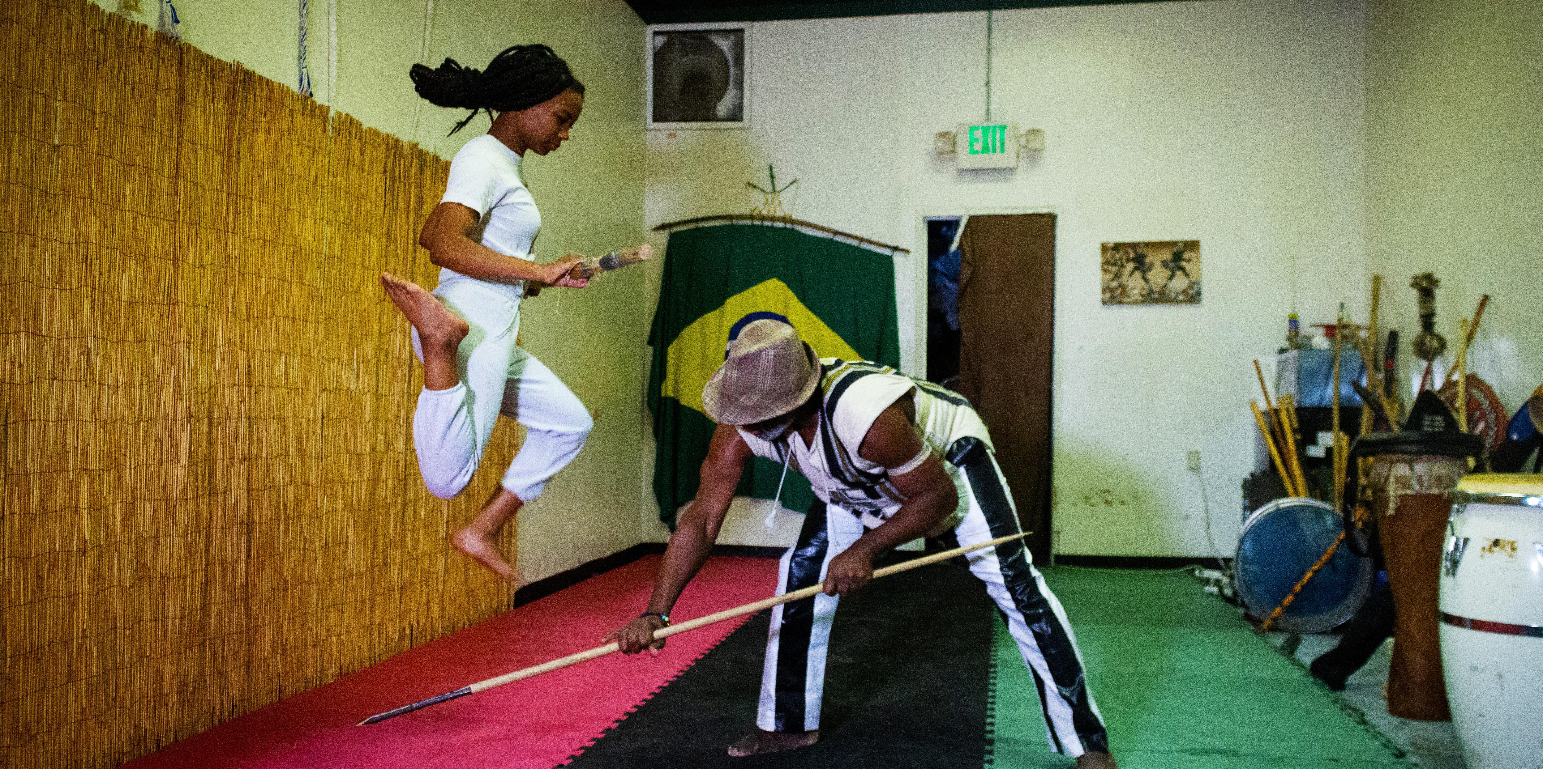 Nadia leaps over Dennis stick_edited