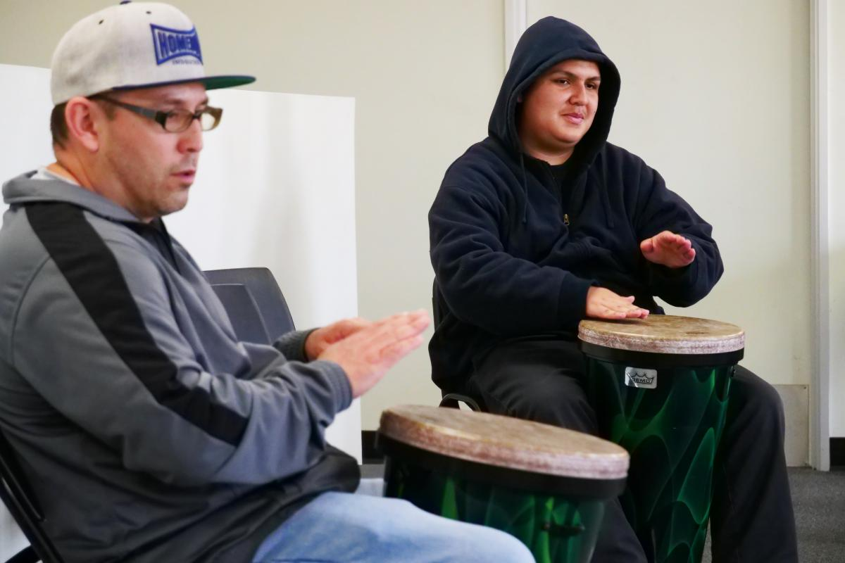 Participants in the Reentry Through the Arts program learning Afro-Colombian drumming at Homeboy Industries. Photo by Shweta Saraswat/ACTA.